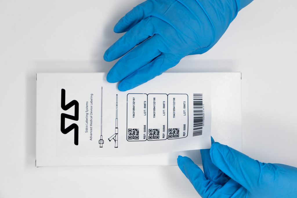 healthcare medical device label being applied to box