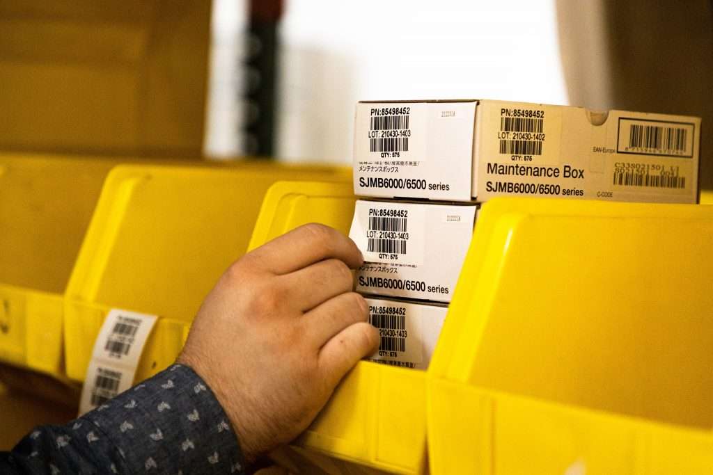 ware house inventory label being applied on box